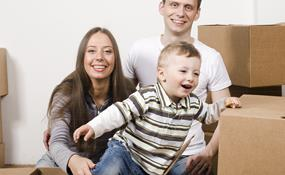 young family with packing boxes
