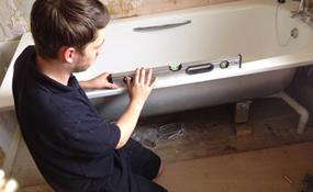 plumbing engineer fixing bath