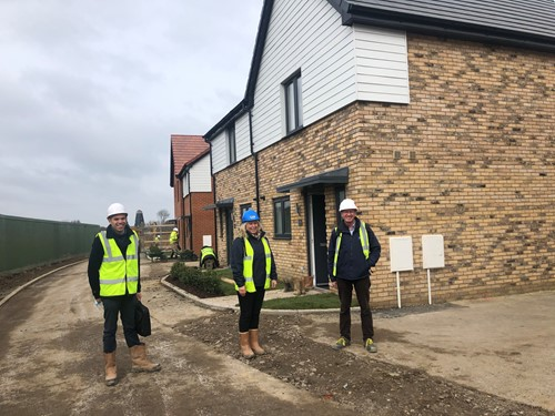 Three staff members on site checking new homes